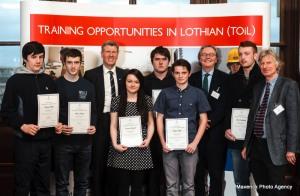 Justice Secretary Kenny MacAskill MSP, congratulates young training graduates.