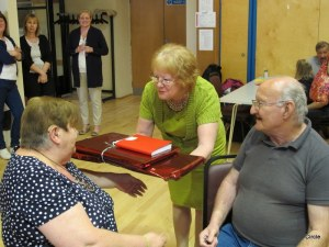 Mae and Bob Receiving Presents From Liz Dahl, Chief Exec